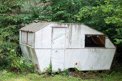 Robbed abandoned caravan. In the green garden Royalty Free Stock Images