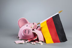Robbed piggy bank with German flag. Broken piggy bank with German flag Stock Image