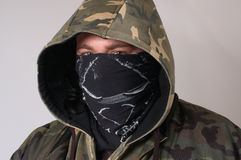 Robber. A man dressed as a robber, isolated Royalty Free Stock Image