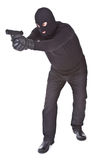 Robber aiming with his gun Royalty Free Stock Photography