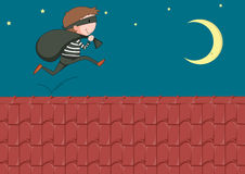 Robber with bag running on the roof Stock Images