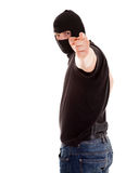 Robber in the balaclava pointing on you Stock Images