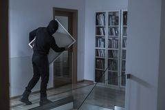 Robber in black mask Royalty Free Stock Images