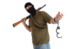 Robber in black mask with shotgun removing handcuffs Stock Images