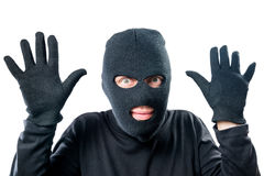 Robber in black protective clothing with hands up close-up Royalty Free Stock Photo