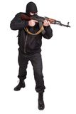 Robber in black uniform and mask with kalashnikov Stock Photography