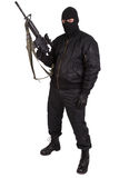 Robber in black uniform and mask with m4 rifle Royalty Free Stock Photo