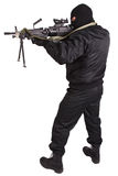 Robber in black uniform and mask with machine gun Royalty Free Stock Photo