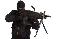 Robber in black uniform and mask with machine gun Royalty Free Stock Photography