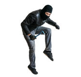 Robber or burglar creeping on tiptoe. Isolated on white. Stock Photography