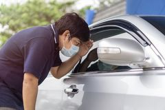 Robber and the car thief in a mask opens the door of the car and hijacks the car Stock Photography