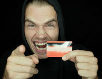 Robber with credit card. Isolated on black stock image