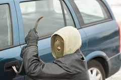 Robber with a crowbar Stock Photo