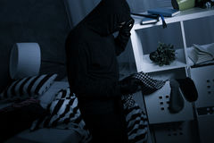 Robber in dark messy room Royalty Free Stock Photography