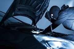 Robber Disabling Car Alarm Royalty Free Stock Images