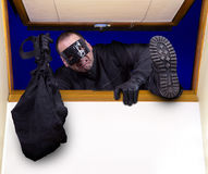 A robber enters the house Royalty Free Stock Photo