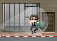 Robber escaping out of the prison Stock Images