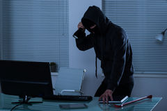 Robber With Flashlight In Office Royalty Free Stock Photo