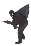 Robber with flashlight and sack Stock Photography