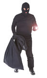 Robber with flashlight and sack isolated Stock Photos