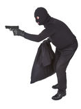 Robber with gun. Robber aiming with his gun isolated on white Royalty Free Stock Photo