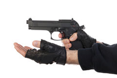Robber with gun holding out hand Stock Photography
