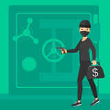 Robber with gun near safe. Royalty Free Stock Photos