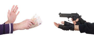 Robber with gun taking money from victim Royalty Free Stock Image