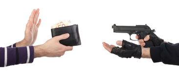 Robber with gun taking wallet from victim royalty free stock photography