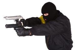 Robber with handgun Royalty Free Stock Photo