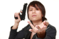 Robber with a handgun Royalty Free Stock Photography