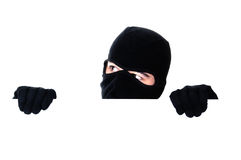 Robber hiding under a wall Stock Images