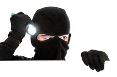 Robber hiding under a white wall. Robber hiding under a wall on white background Royalty Free Stock Image