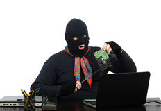 Robber holding in one hand a hard drive Royalty Free Stock Images