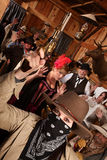 Robber Holds Up Customers in Saloon stock image