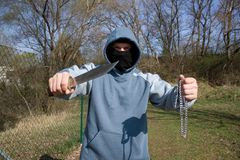 Robber with a knife. Assault with a weapon, a masked robber Stock Photography