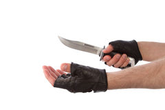 Robber with knife holding out hand Stock Photos