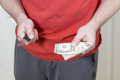 Robber with knife and money. Stock Photos