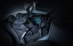 Robber Looking For Valuables. Inside the Car at Night. Car Robber Stock Image