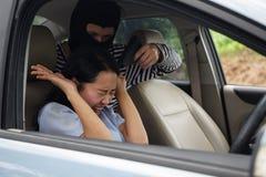 Robber man point  gun at car owner Royalty Free Stock Photography