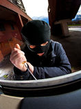Robber in a mask Stock Photo