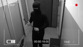 The robber in the mask c has a crowbar in his hands were under camera surveillance.  Stock Images