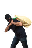 Robber in a mask carries bag with money