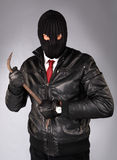 Robber in a mask with a crowbar Royalty Free Stock Photos