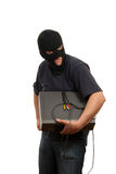 Robber in a mask with device in hands Royalty Free Stock Images