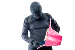 Robber pulls out a purse from a female bag on a white Royalty Free Stock Photography