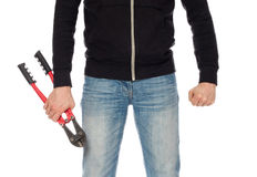Robber with red bolt cutters. Isolated on white Royalty Free Stock Photo