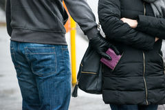 Robber Stealing Clutch From Woman's Jacket On Street Royalty Free Stock Photo