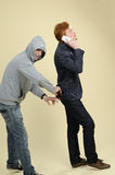 Robber stealing wallet Stock Photography