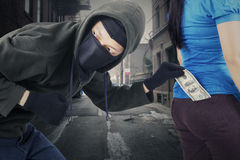 Robber stole money on the alley Stock Photo